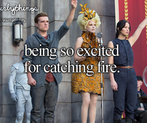catching fire, excited, and peeta image