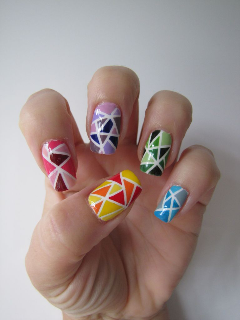 Stained glass nail art with different colours on each nail