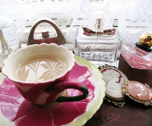 cup and perfume image