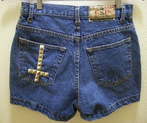 cross, shorts, and studded image