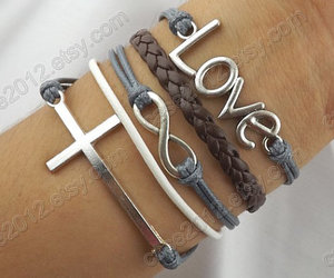 cross bracelets, anchor bracelet, and love bracelet image
