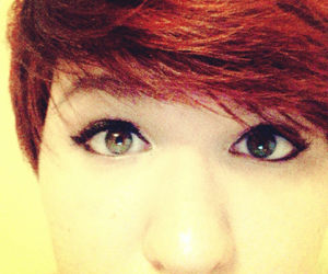 green eyes, red hair, and pixie cut image