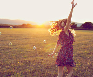 girl, sun, and bubbles image