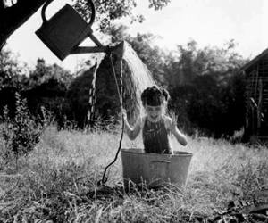 child, water, and black and white image