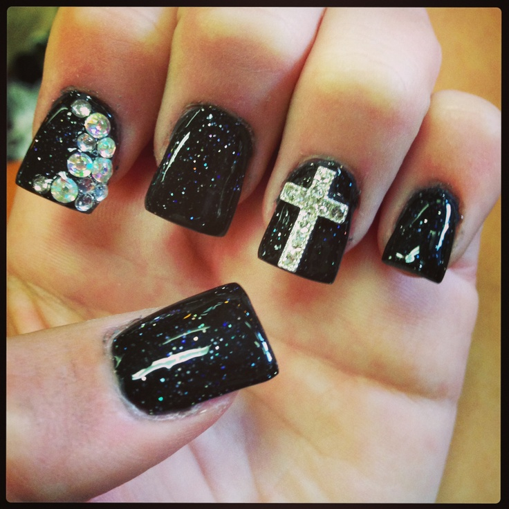 Black with silver glitter cross and a slight design and one