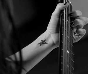 Avril Lavigne, guitar, and tattoo image