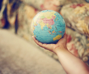 world, hand, and travel image