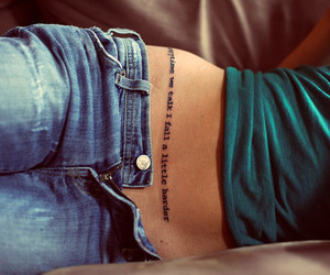 tattoo and jeans image