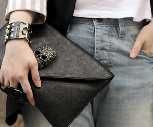 clutch, jeans, and skull image