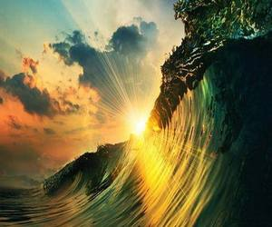 waves, sun, and sunset image