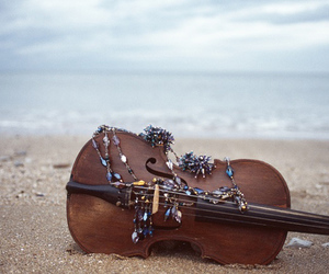 violin and beach image