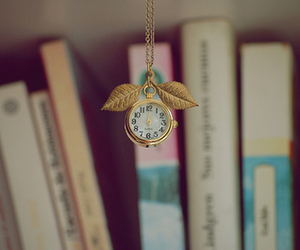 book, clock, and gold image