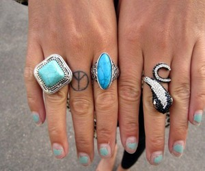 rings and tattoo image