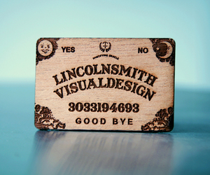 business card, typography, and lazer cut image