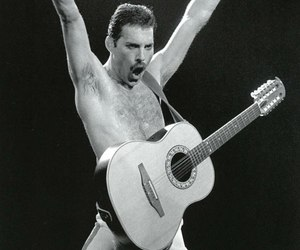 Queen, Freddie Mercury, and guitar image