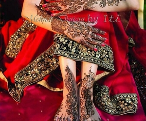 henna, red, and wedding image