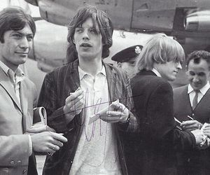 mick jagger, Brian Jones, and charlie watts image