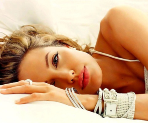 Angelina Jolie, bracelets, and pillow image