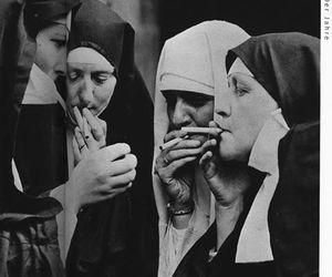 nun, cigarette, and black and white image