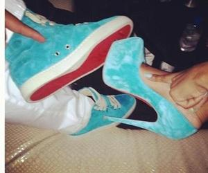 couple, high heels, and sneakers image