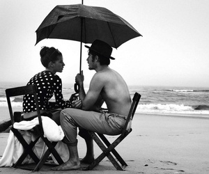 beach, couple, and umbrella image