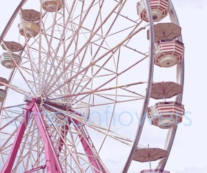 pink and ferris wheel image