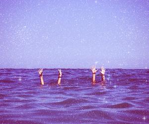 sea, ocean, and hands image