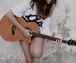 girl, wall, and guitar image