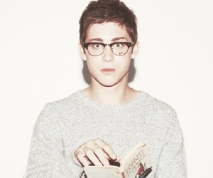logan lerman, boy, and book image