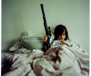 gun, girl, and bed image