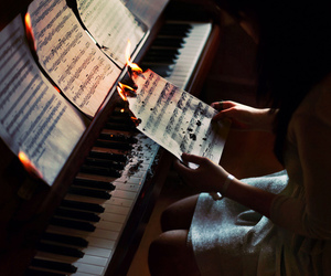 piano, music, and fire image