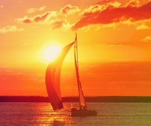 red, sail, and sun image