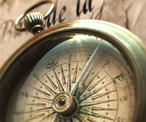 clock, compass, and god image