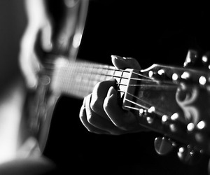 black & white, playing, and guitar image