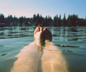 lake, legs, and swimming image