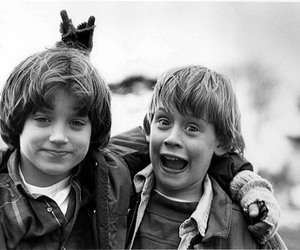 elijah wood, Macaulay Culkin, and black and white image