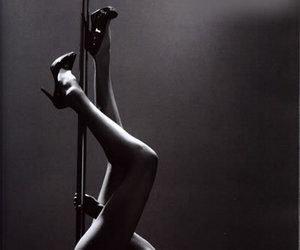 black and white, girl, and pole image