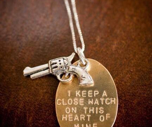 necklace, gun, and heart image