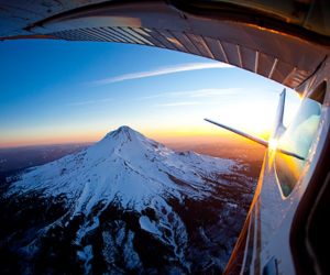 mountain, plane, and sky image