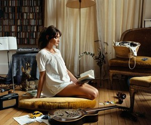 book, Carla Bruni, and guitar image