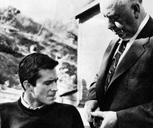 alfred hitchcock, anthony perkins, and black and white image