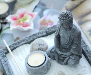 Buddha, candle, and flower image
