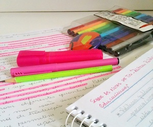 notebook, pens, and pink image