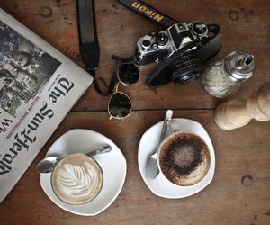 camera, coffee, and newspaper image