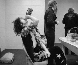 jimmy page, led zeppelin, and jack daniels image