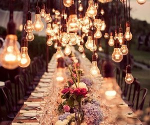 flowers, lights, and table image