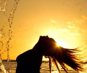 girl, sea, and sun image