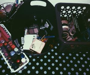Brushes, desk, and eyeliner image