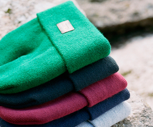 green, red, and beanies image