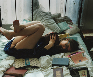 bed, lying down, and legs up image
